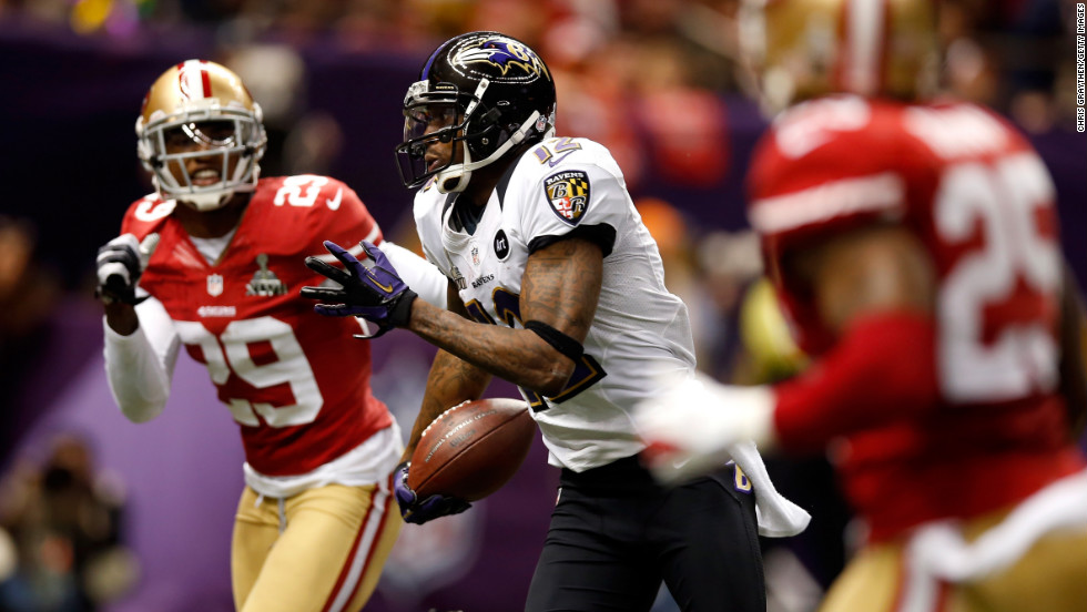 Jacoby Jones of the Ravens runs on a 56-yard touchdown pass past  Chris Culliver of the San Francisco 49ers.