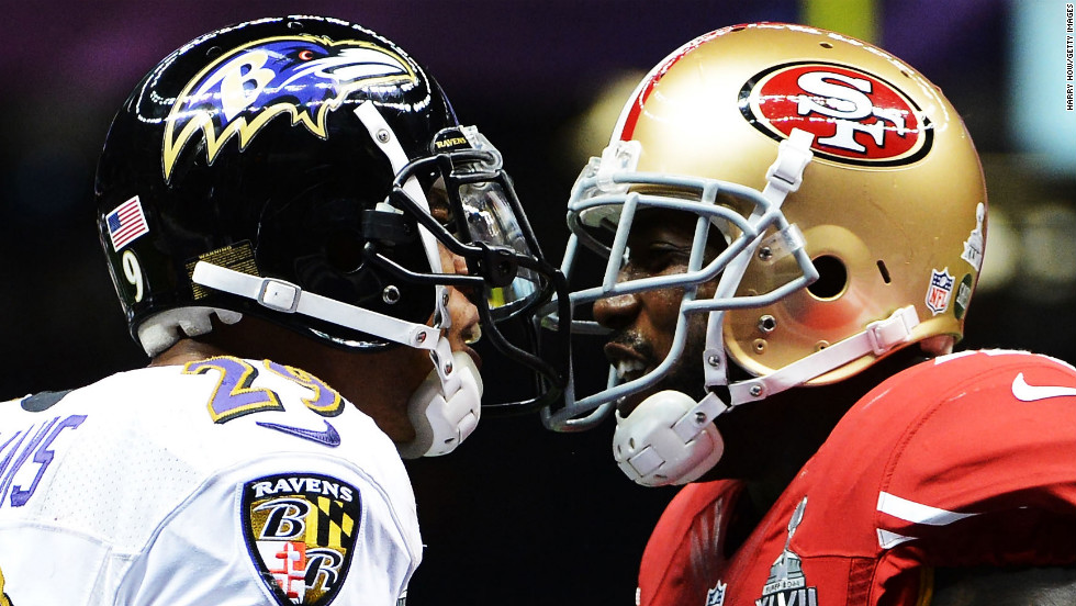 Cary Williams of the Ravens exchanges words with Delanie Walker of the 49ers.
