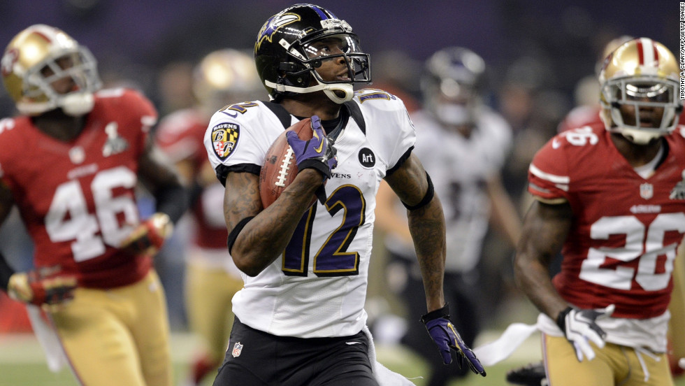 Jacoby Jones of the Baltimore Ravens returns the second-half kickoff 108 yards for a record-tying touchdown.