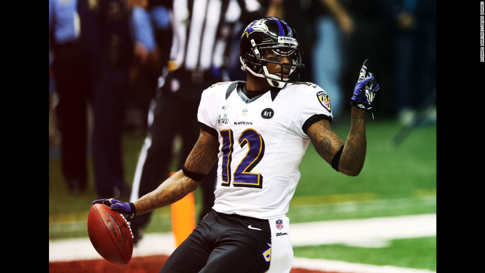 Ravens kick returner Jacoby Jones celebrates his touchdown at the start of the second half.