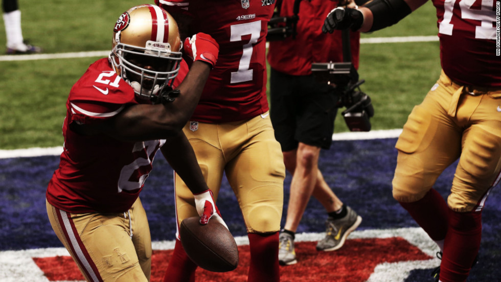 Frank Gore of the 49ers celebrates his 6-yard rushing touchdown in the third quarter.