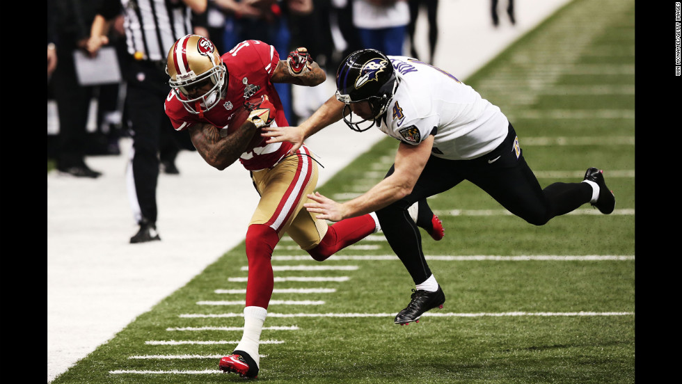Ted Ginn Jr. of the 49ers returns a punt 32 yards against Sam Koch of the Ravens.