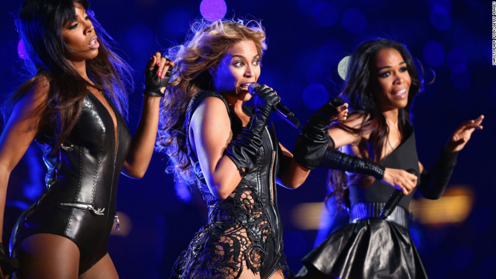Kelly Rowland, left, Beyonce Knowles and Michelle Williams of Destiny's Child perform during the show.