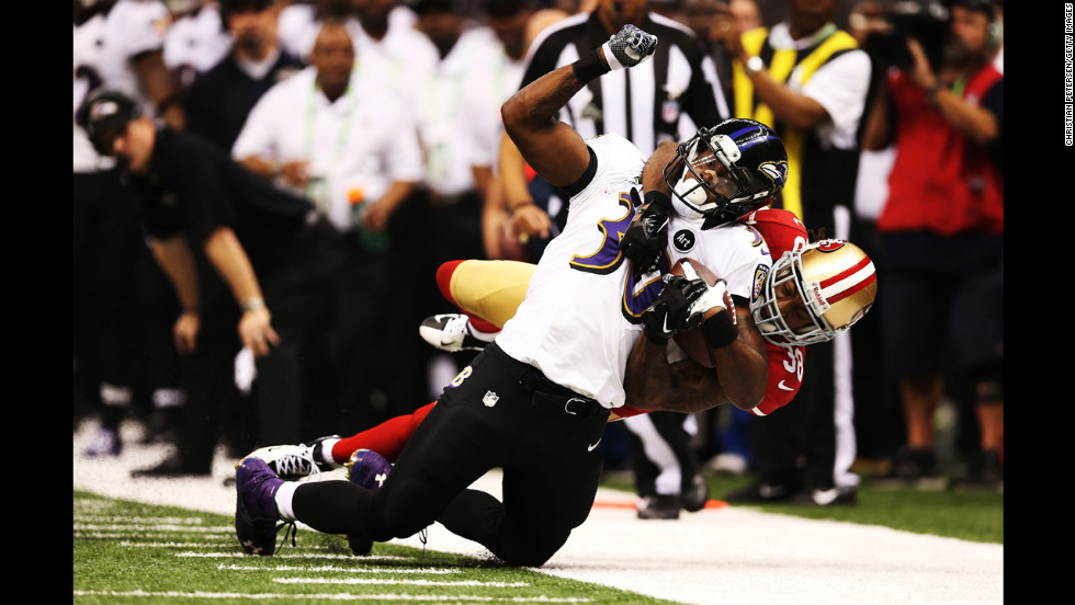 Bernard Pierce of the Baltimore Ravens is tackled by Dashon Goldson of the 49ers.