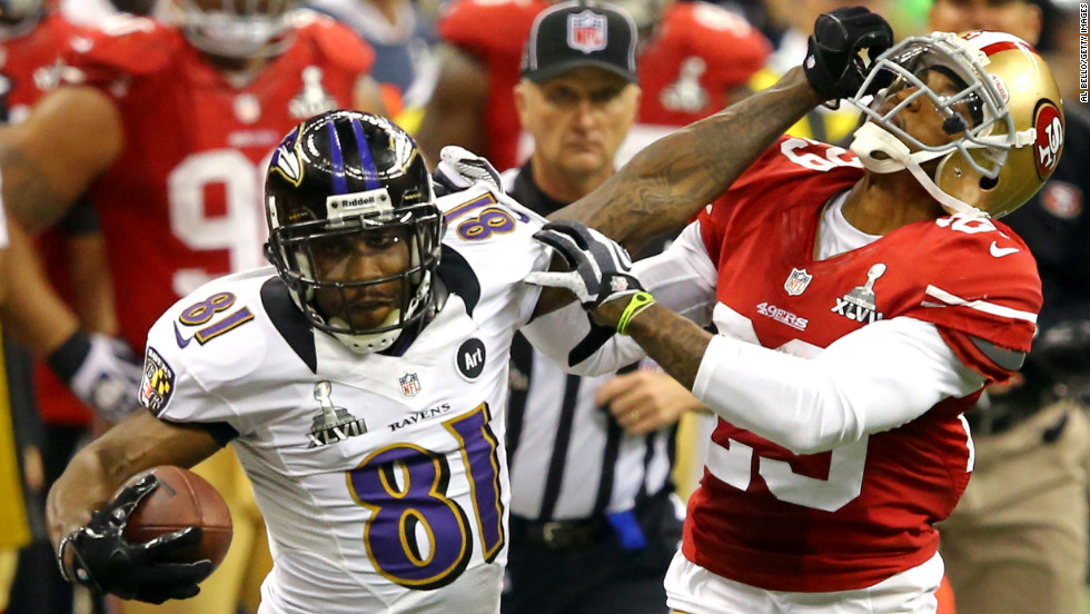Anquan Boldin of the Baltimore Ravens stiff-arms Chris Culliver of the San Francisco 49ers after catching a 30-yard pass in the third quarter.