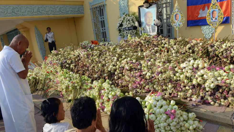 Cambodians pray for their late former king Norodom Sihanouk in front of the Royal Palace in Phnom Penh on Sunday.