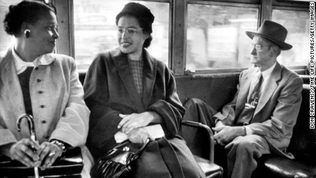 Rosa Parks (C) riding on newly integrated bus following Supreme Court ruling ending successful 381 day boycott of segregated buses. Boycott began when Parks was arrested for refusing to give up her seat to a white person.  (Photo by Don Cravens//Time Life Pictures/Getty Images)