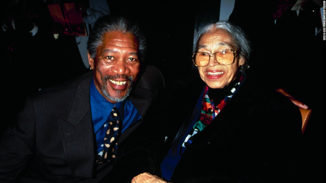 "Actor Morgan Freeman joins Parks at a film premiere party for ""Amistad"" in 1997."