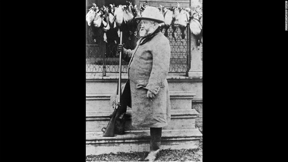 Benjamin Harrison poses with a gun in this portrait, circa 1880s.