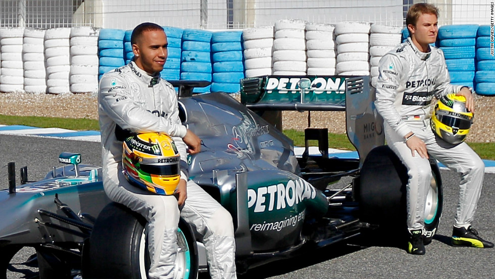 Former McLaren star Lewis Hamilton, left, and new teammate Nico Rosberg pose with the new Mercedes W04 on February 4.