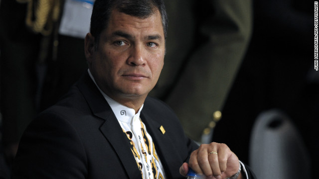 Ecuador's President Rafael Correa opens a water bottle during the plenary of the XLIII Mercosur presidential summit in Mendoza, 1050 Km west of Buenos Aires, Argentina on June 29, 2012.