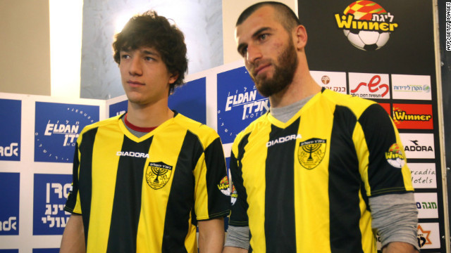 Chechen football players Dzhabrail Kadaev (L) and Zaur Sadaev, are introduced by the Beitar Jerusalem football club on January 30.