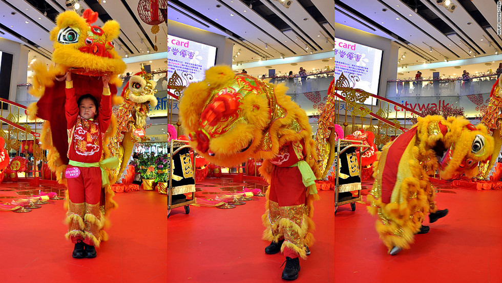 Following the opening ritual, a sequence of open-closed footwork begins -- dancers jump up and down alternating open legs and closed legs. This is demonstrated admirably here (left) by Chiu Po Ying, age nine.<br /><br />Then, the lion will playfully chase its own tail -- or another lion's tail if there are two lions. This step (pictured middle and right) demonstrates the happiness and energy of the lion.