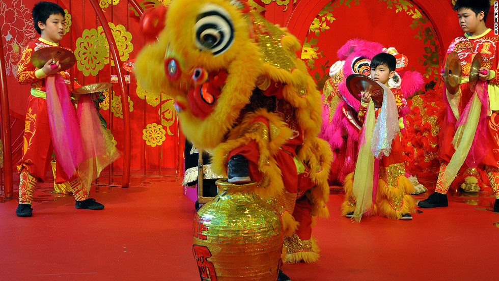 "All seems fine. The lead dancer steps his or her foot on the prey. <br /><br />""Pay attention to the lion's expression,"" says Ha. ""See how the eyes are closed when it's smelling the wine. Lion dancers will drag the wine bottle away from its original position, just as a real predator would do."""