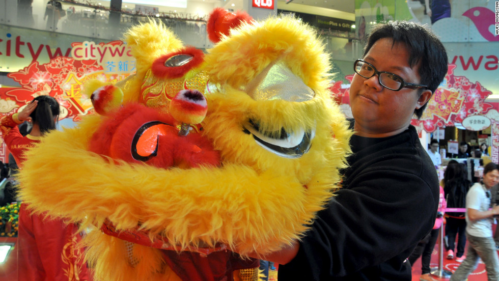 "Master Ha, 28, showing a lion with half-closed eyelids. <br /><br />His family's dragon and lion dance business has been operating for three generations. Ha has been practicing martial arts and lion dance since he was three years old. <br /><br />""The fifth day of LNY (February 4) is a very good (feng shui) day to begin business this year, so we've been booked to tour a few shopping malls on that day including IFC, CityWalk and Harbour City,"" said Ha.<br /><br /><em>Travelers interested in experiencing the lion dance can book a class with the Ha Tak Kin Martial Art Society. The school welcomes groups of six or above, each class costs about HK$200 ($26) per person.</em><br /><br /><em><a href=""http://liondance.com.hk/pub/org/"" target=""_blank"">Ha Tak Kin Martial Art Society Ltd.</a></em><em>, 2/F, 460 Nathan Road, Kowloon, Hong Kong; +852 2384 0610</em><br /><br /><em>IFC, 8 Finance Street, Central, Hong Kong; +852 2295 3308</em><br /><br /><em>CityWalk, 1 Yeung Uk Road, Tsuen Wan, Hong Kong; +852 3926 5700</em><br /><br /><em>Harbour City, 7-27 Canton Road, Tsim Sha Tsui, hong Kong; +852 2118 8666</em><br /><br /><em>Story original published February 2013. Updated January 26, 2014.</em>"
