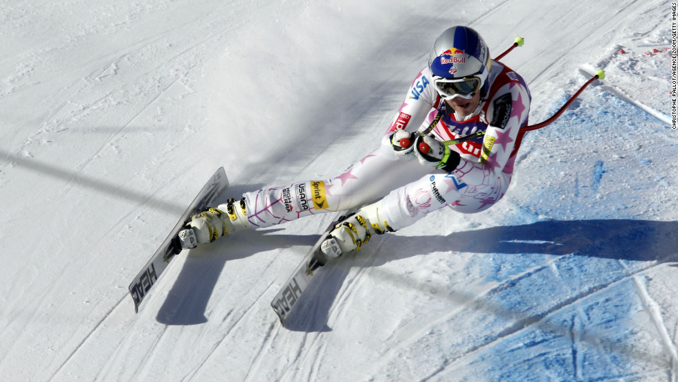 Vonn sprays powder during the Audi FIS Alpine Ski World Cup women's downhill on January 19, 2013, in Cortina D'ampezzo, Italy. She took first place.