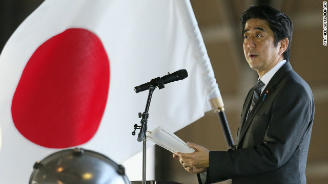 Japanese PM Shinzo Abe delivers a speech on February 2 on Okinawa near the disputed islands.