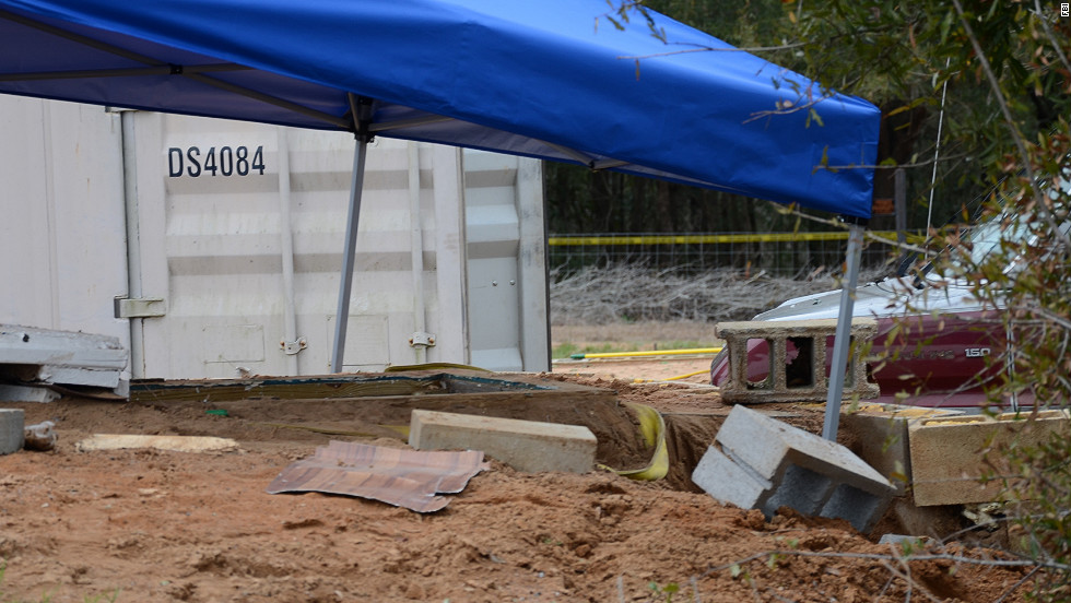 A tent covers the bunker where the standoff took place. An FBI team rescued the child and killed Dykes during the operation on  February 4.