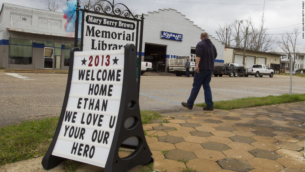 A sign celebrating Ethan's rescue stands in front of the Mary Berry Brown Memorial Library in Midland City on February 5.