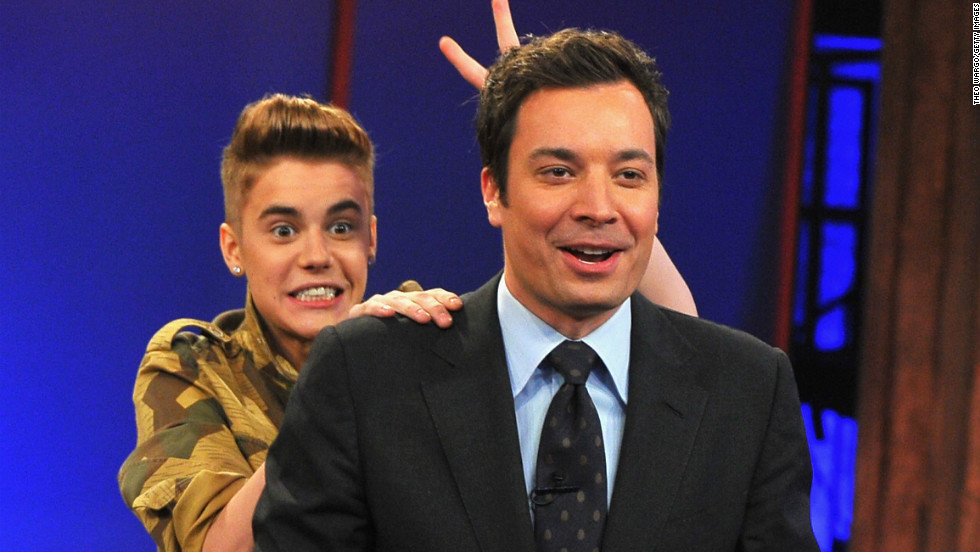 "Justin Bieber does a little photobombing of Jimmy Fallon at a taping of ""Late Night"" on February 5."