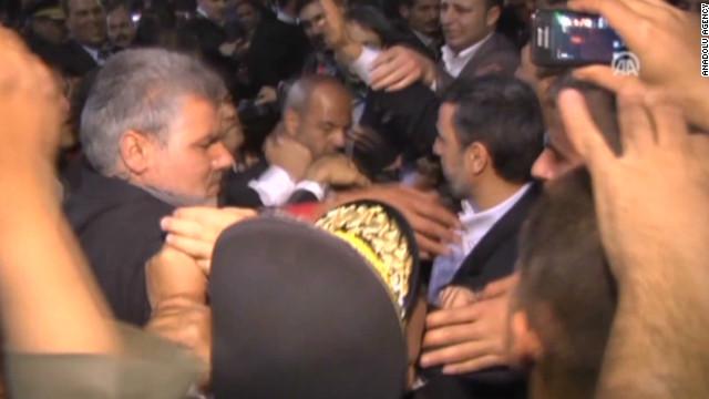 Watch man hurl shoe at Iran's president
