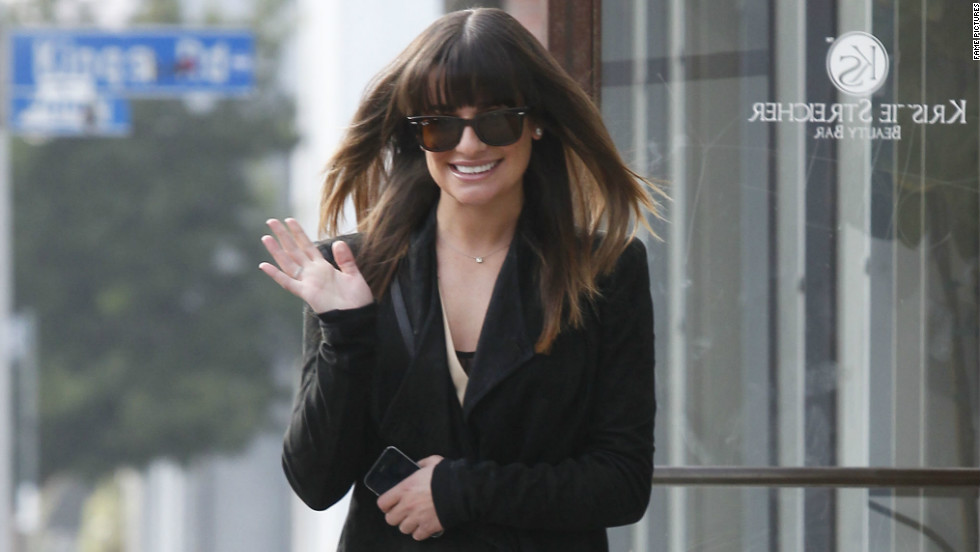 Lea Michele waves as she exits a salon on February 5.