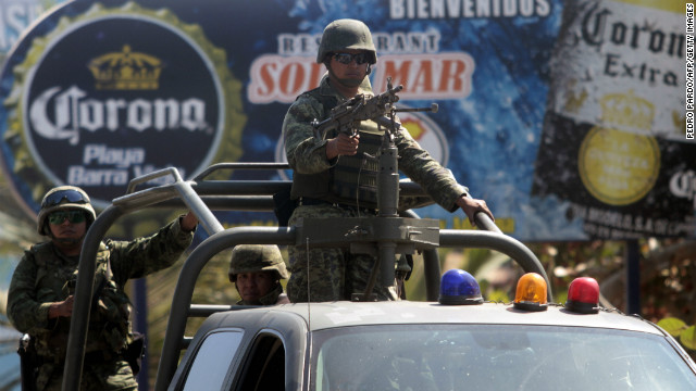 (File) Soldiers stand guard in Acapulco, in the Mexican state of Guerrero, on February 5, 2013.