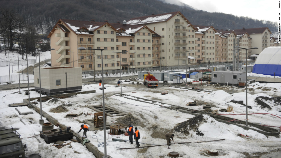 The total cost is expected to top $50 billion, with much of the infrastructure being built from scratch. This picture taken on January 24 shows a view of a new hotel constructed near a railway station between Adler and Krasnaya Polyana Olympic venues in the Caucasus Mountains.