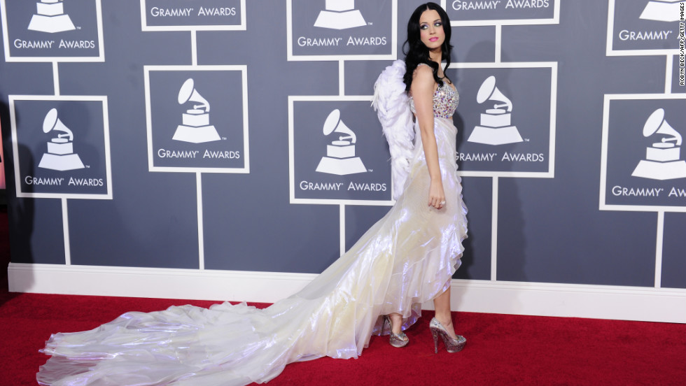 Katy Perry's 2011 red carpet look included a sparkly bra top and wings.