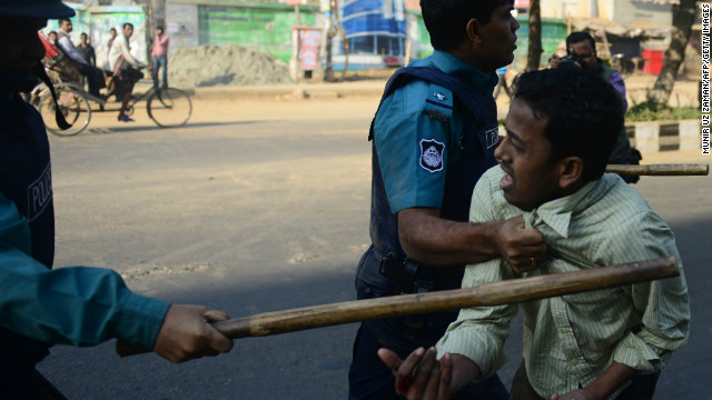 (File photo) Police charge a suspected Jamaat-e-Islami activist during a nationwide strike in Dhaka on February 6, 2013.