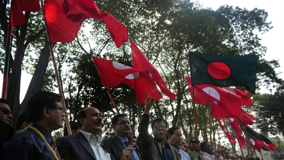 Activists and former freedom fighters who fought against Pakistan in the 1971 war demonstrate outside the court in Dhaka on February 5.