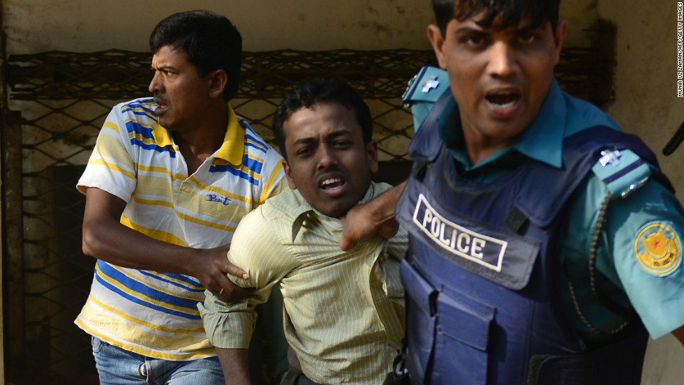 Bangladeshi police detain a suspected Jamaat-e-Islami activist during a nationwide strike in Dhaka on February 6.