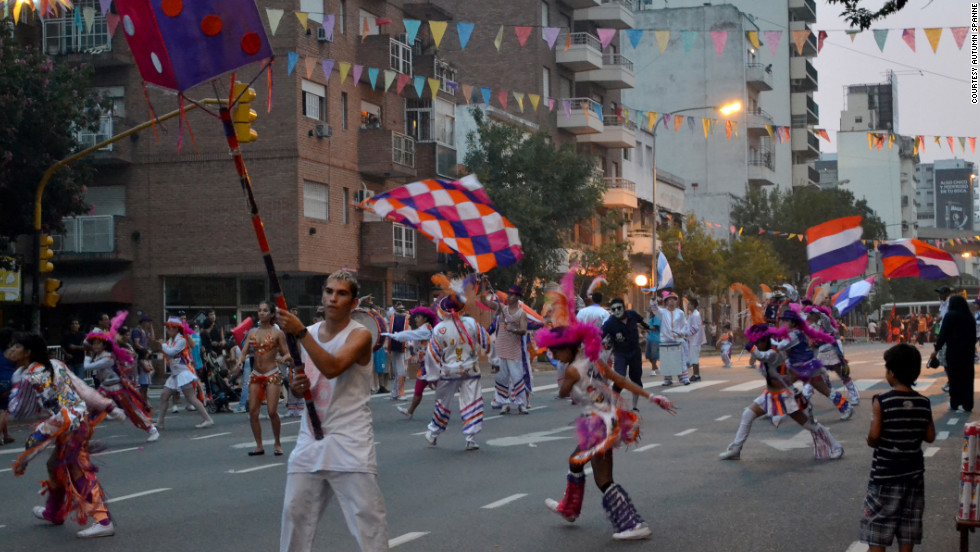 Dancers make their way up a street in Buenos Aires' San Telmo neighborhood.
