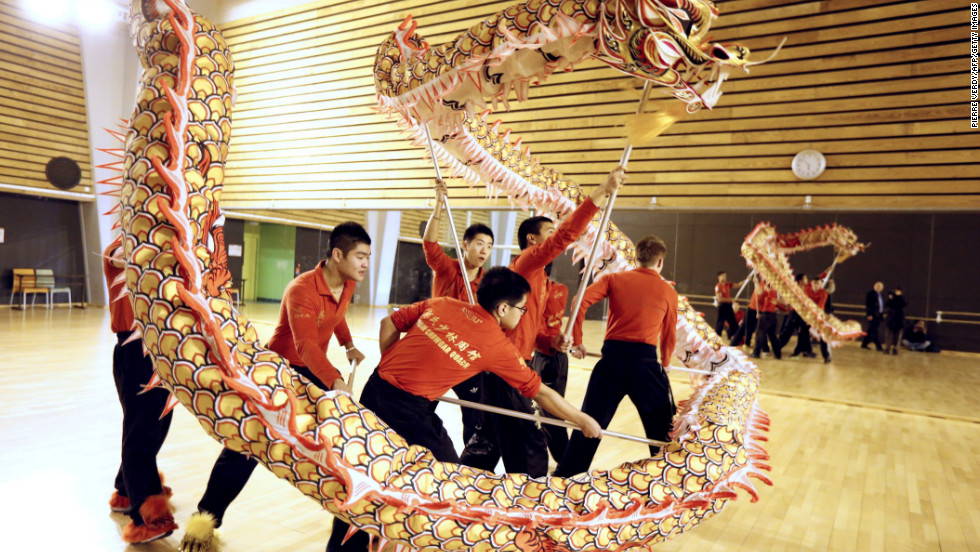 A dance team trains with dragons in a Paris gymnasium on Wednesday, February 6, ahead of the traditional Chinese New Year festivities.