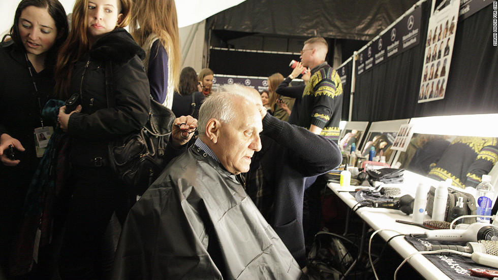 French designer Max Azria gets his hair cut behind the scenes on February 6.