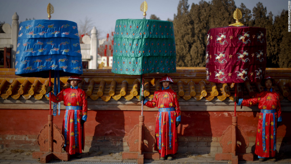 Actors in traditional imperial costumes take part in a re-enactment February 8 at the Temple of Earth in Beijing.