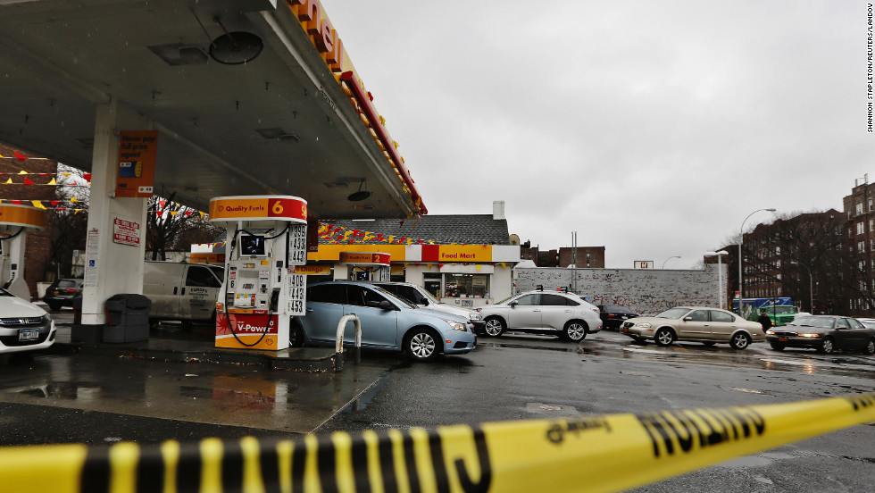 Cars are lined up outside a gas station in Queens borough of New York on February 8.