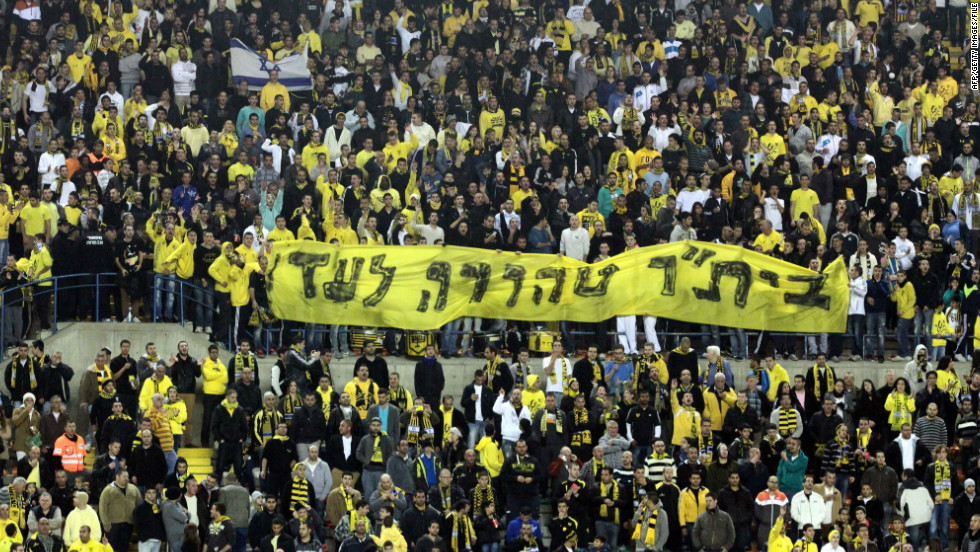 "Beitar Jerusalem fans display a banner reading ""Beitar -- pure forever"" at a match on January 26 after their signing of two Muslim players."