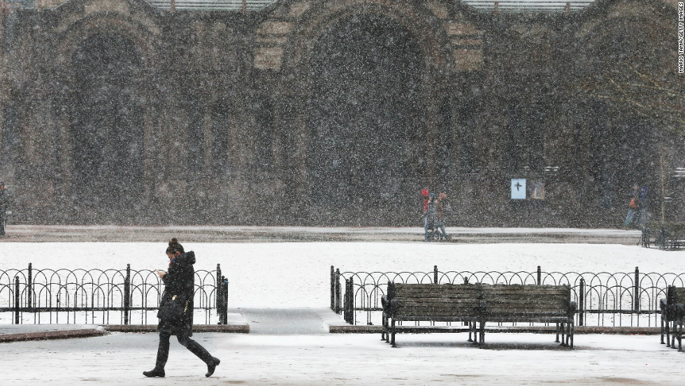 A woman walks through the snow past Copley Square on Friday in Boston. Massachusetts and other states from New York to Maine are preparing for a major blizzard with possible record amounts of snowfall in some areas.