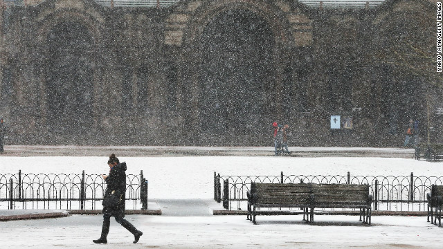 A woman walks through the snow past Copley Square on February 8, 2013 in Boston, Massachusetts. Massachusetts and other states from New York to Maine are preparing for a major blizzard with possible record amounts of snowfall in some areas.