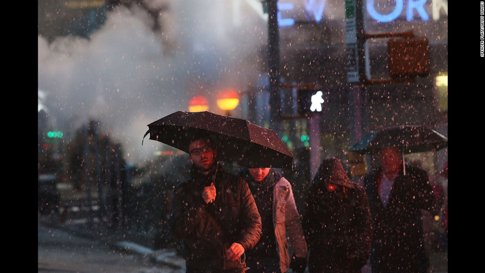 Pedestrians battle wind, snow and sleet in Manhattan on Friday.