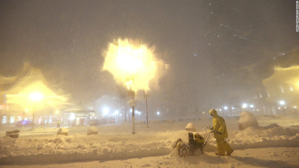 A man operates a snowblower while a blizzard arrives in the Back Bay neighborhood in Boston on February 8.