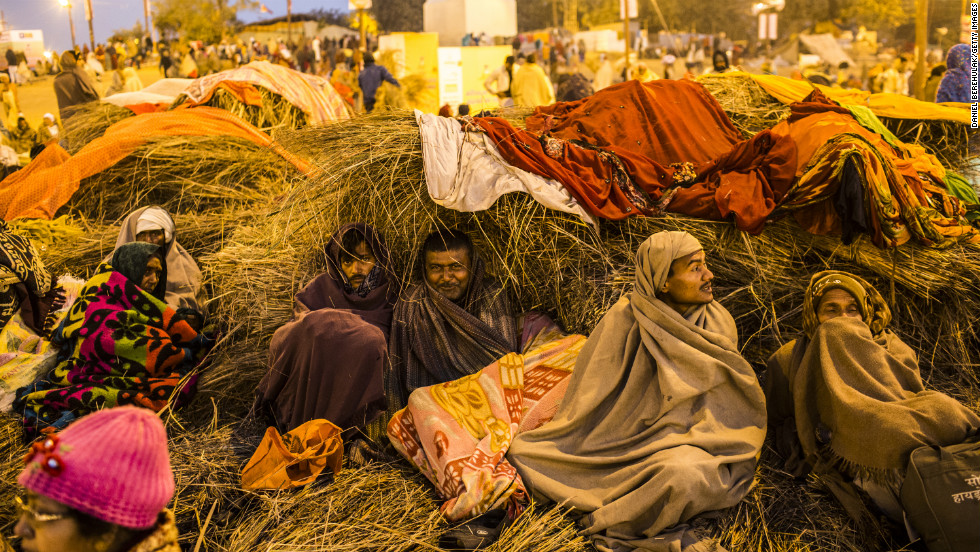 Devotees warm themselves early in the morning before taking a bath on the banks of Sangam on February 9.