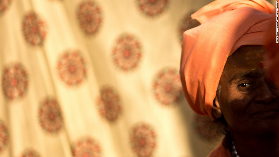 A Sadhvi, or holy woman, sits inside her tent on February 8.