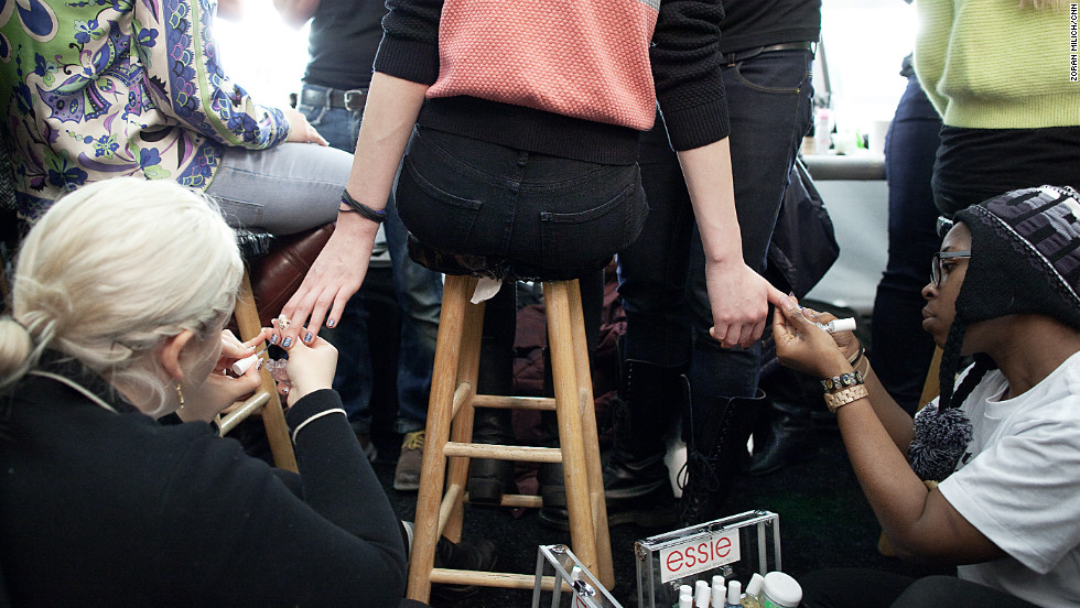 A model has her nails painted at the Rebecca Minkoff show on Friday, February 8.