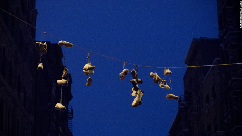 Snow gathers on shoes hung from power lines in the Lower East Side of New York City.