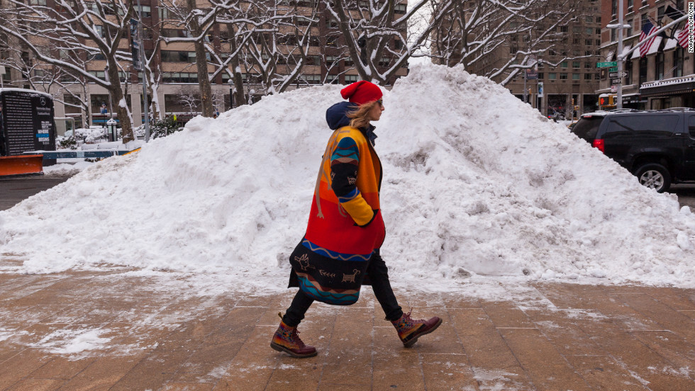 A model walks by a mound of snow on February 9.
