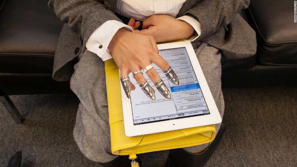 A fashionable iPad user checks e-mails on February 9.