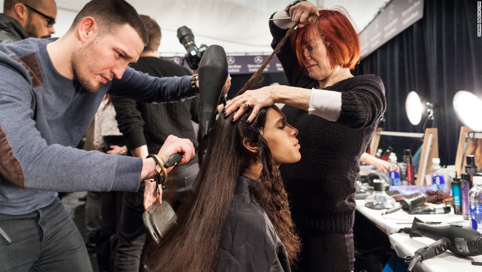 A model gets her hair straightened for the Mara Hoffman Show on February 9.