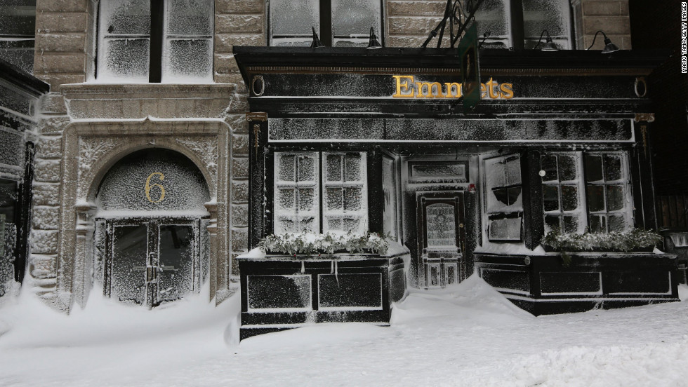 Emmet's on Beacon Street is covered in snow in Boston on Saturday.